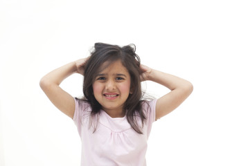Portrait of young girl scratching her head