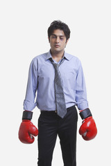 Injured Executive wearing boxing gloves