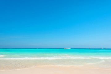 Wall Mural - Wonderful tropical beach, Scenery blue and bright sea with blue sky, Beautiful exotic beach for relaxation