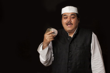 Portrait of Indian politician holding paper currency
