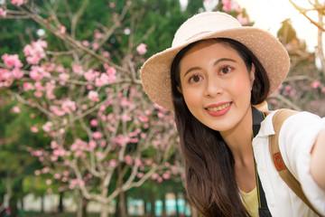 pretty young woman tourist takes selfie portrait