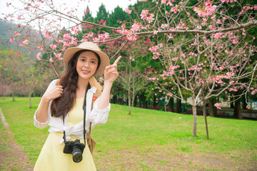 beautiful female blogger visiting cherry park
