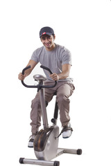 Portrait of young man on exercise bike