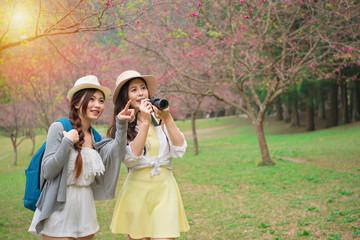 beautiful young women holding travel camera