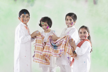 Children wiping their hands on a cloth
