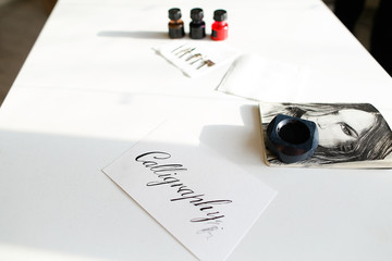 Beautiful postcard with calligraphic inscription of black ink on