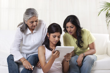Family reading documents at home