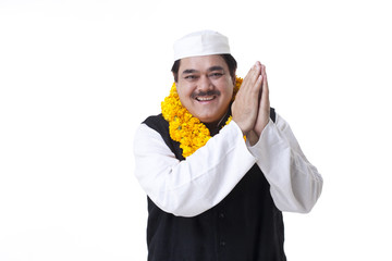 Happy politician greeting over white background