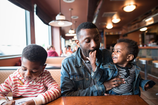 Father and sons in restaurant for lunch