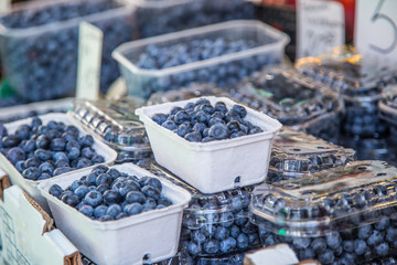 Blueberries on a farm market in the city. Fruits and vegetables at a farmers market
