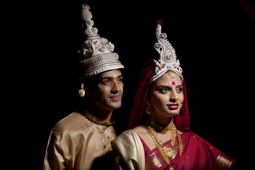 Bengali bride and groom with a topor