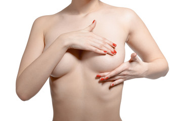 naked girl who carefully verifies hands her breasts