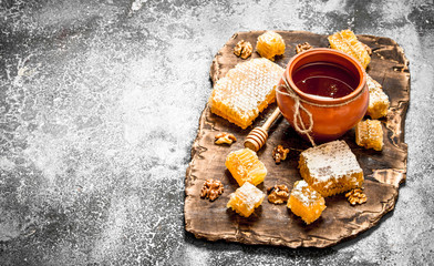 Wall Mural - Honey pot and honeycomb with nuts.