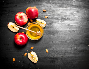 Wall Mural - Honey background. Fresh honey in bowl with ripe apples.