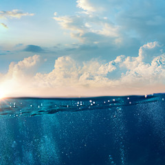 Sky and Sea Water divided by waterline. Ocean aquatic nature design. Tropical shining waters