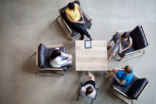 Overhead shot of group of businesswomen in a meeting
