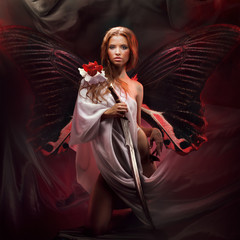 studio portrait of beautiful model with fantasy sword and tropical butterfly wings on dark red abstract background