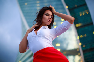Office woman wearing red skirt after work at evening