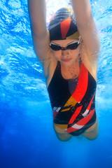 professional female sport master smiling underwater