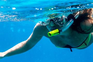 A swimmer underwater snorkeling