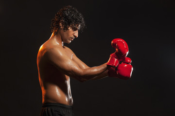 Young man wearing boxing gloves