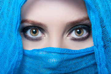 Beautiful female eyes looking above her veil