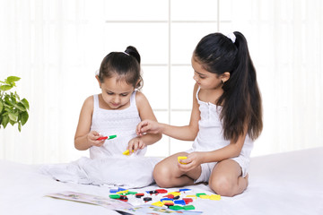 Children playing puzzle game at home