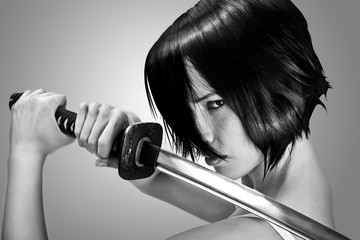 Anime stylized brunettewith short hair watching with stern look holding a katana sword with two hands