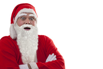 Close-up of surprised Santa Claus with arms folded over white background