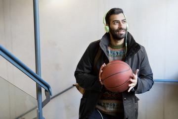 Bearded man holding basketball