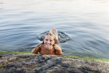 woman swininbg in a lake
