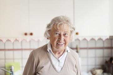 Smiling elderly woman in kitchen