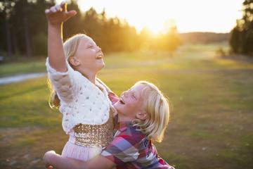 children playng in a field