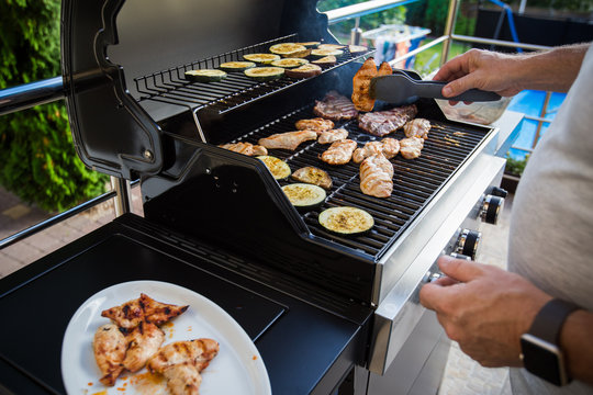 Grill meat in the garden, summer barbecue