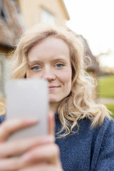 woman holding up her phone