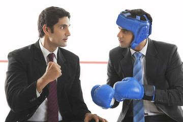 Businessman giving his friend boxing tips