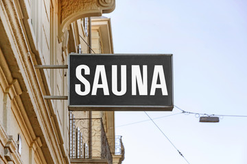 SAUNA signboard on the street at building facade
