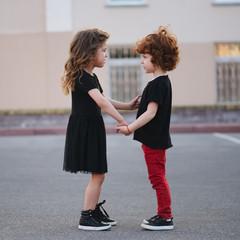 cute little girl edifies boy