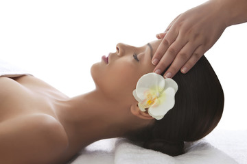 Young woman on massage table getting head massage
