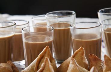 Close-up of hot chai and samosas