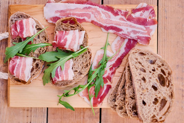 Bread with gourmet meat on a wooden desk.