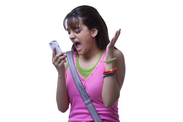 Young woman shouting in mobile phone over white background