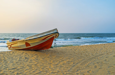 The fishing boat on the sand in Negombo