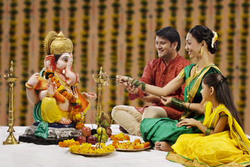 Family performing a pooja