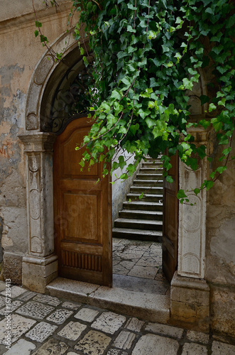 porec old gate with dooor and steps croatia stock photo and