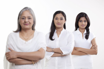 Portrait of three generation family standing over white background
