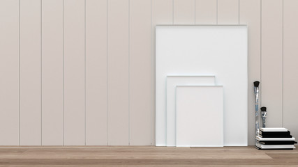 Blank white picture canvasses and paint brushes