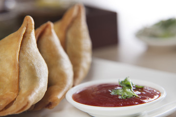 Samosa served with tomato ketchup in plate