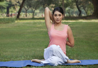 Woman stretching her arms in a yoga