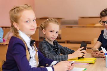 Girls at school desks